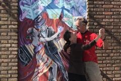 13. John and Ana tango in the street