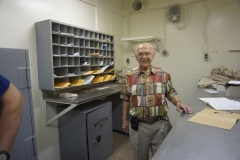 14. Dad in the mailroom where he worked on the ship