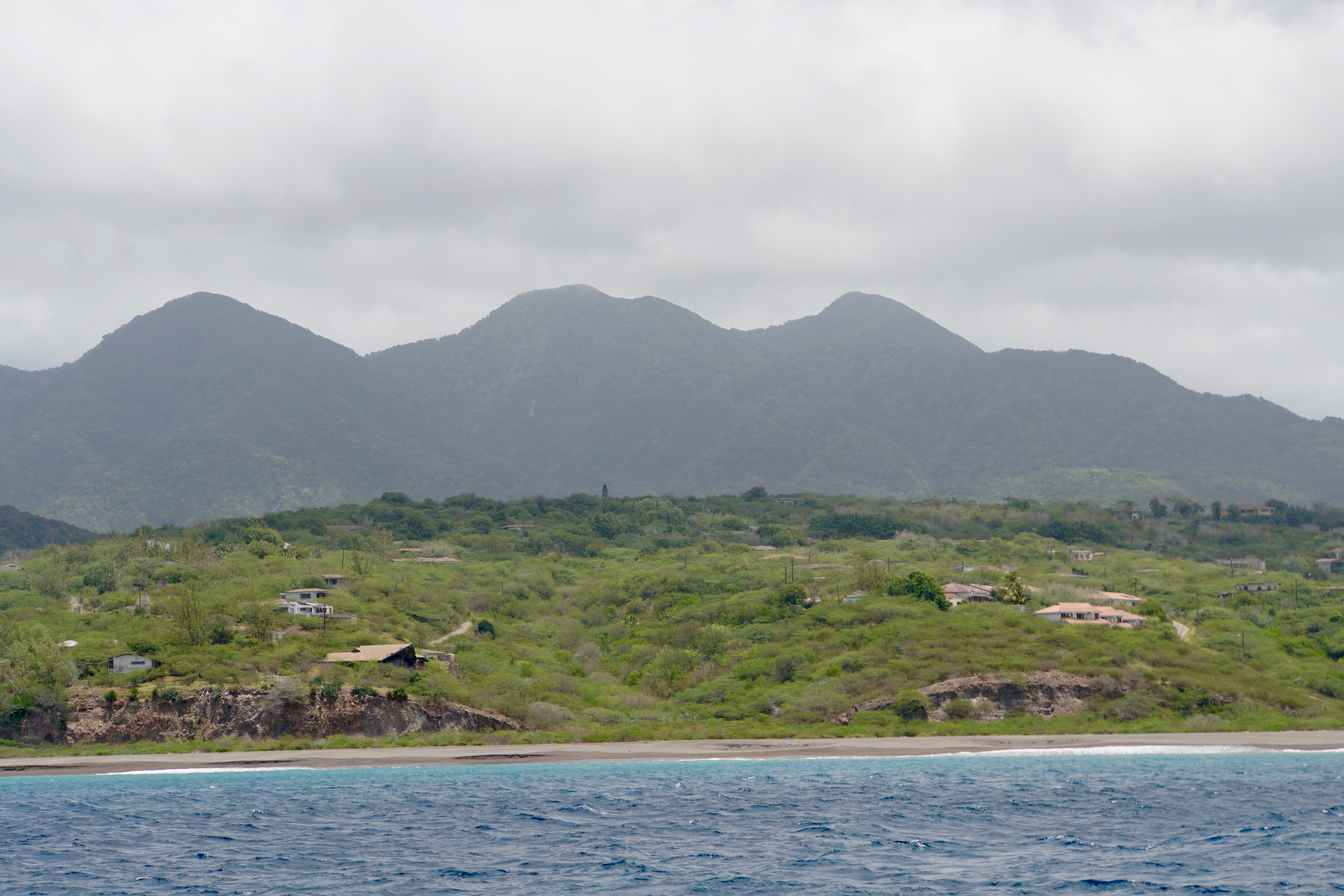 18. starting to see some of the homes buried in ash from the 1995 eruption of the Soufriere Hills Volcano.