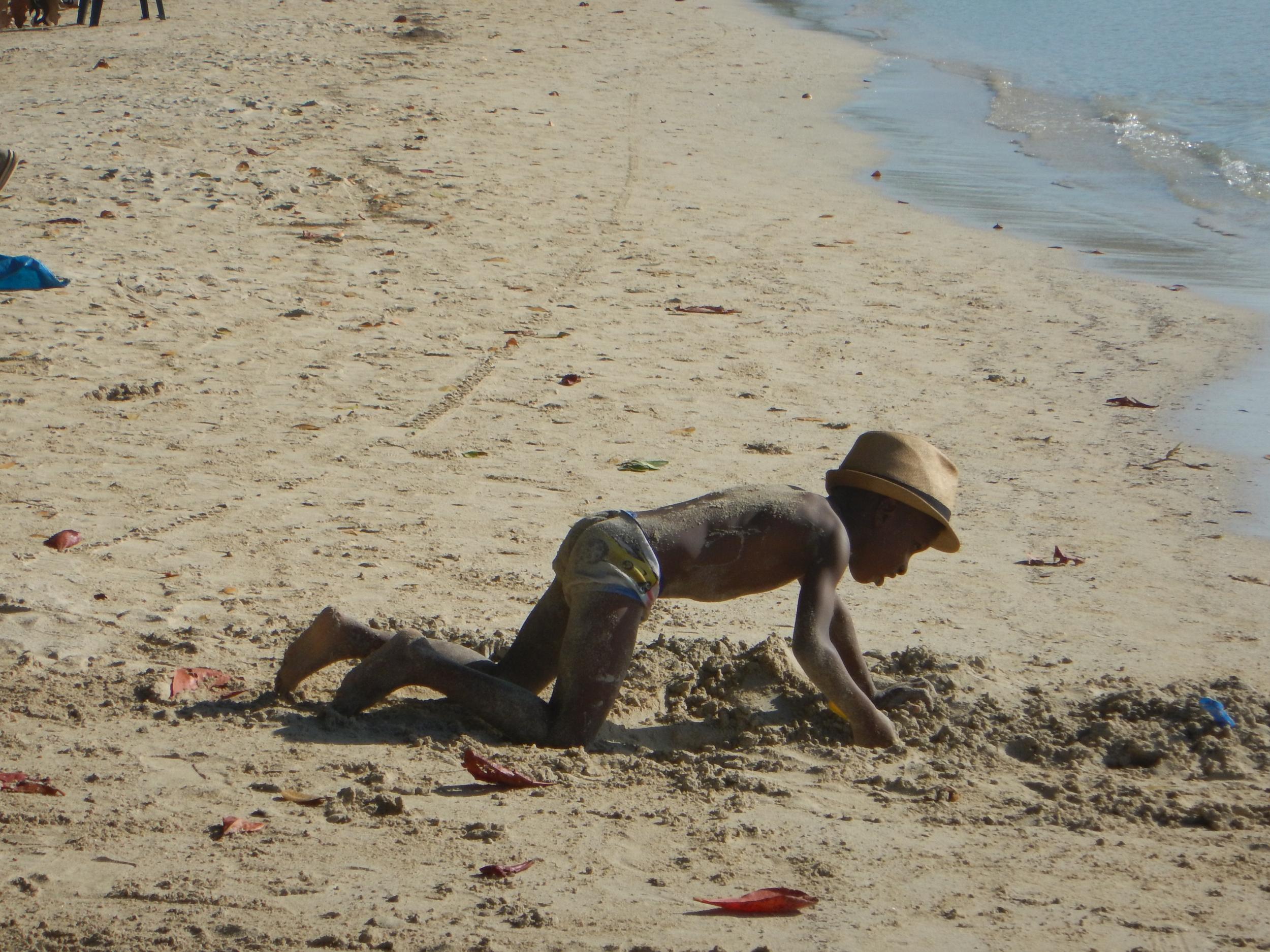 66. Little boy plalying on Negril beach