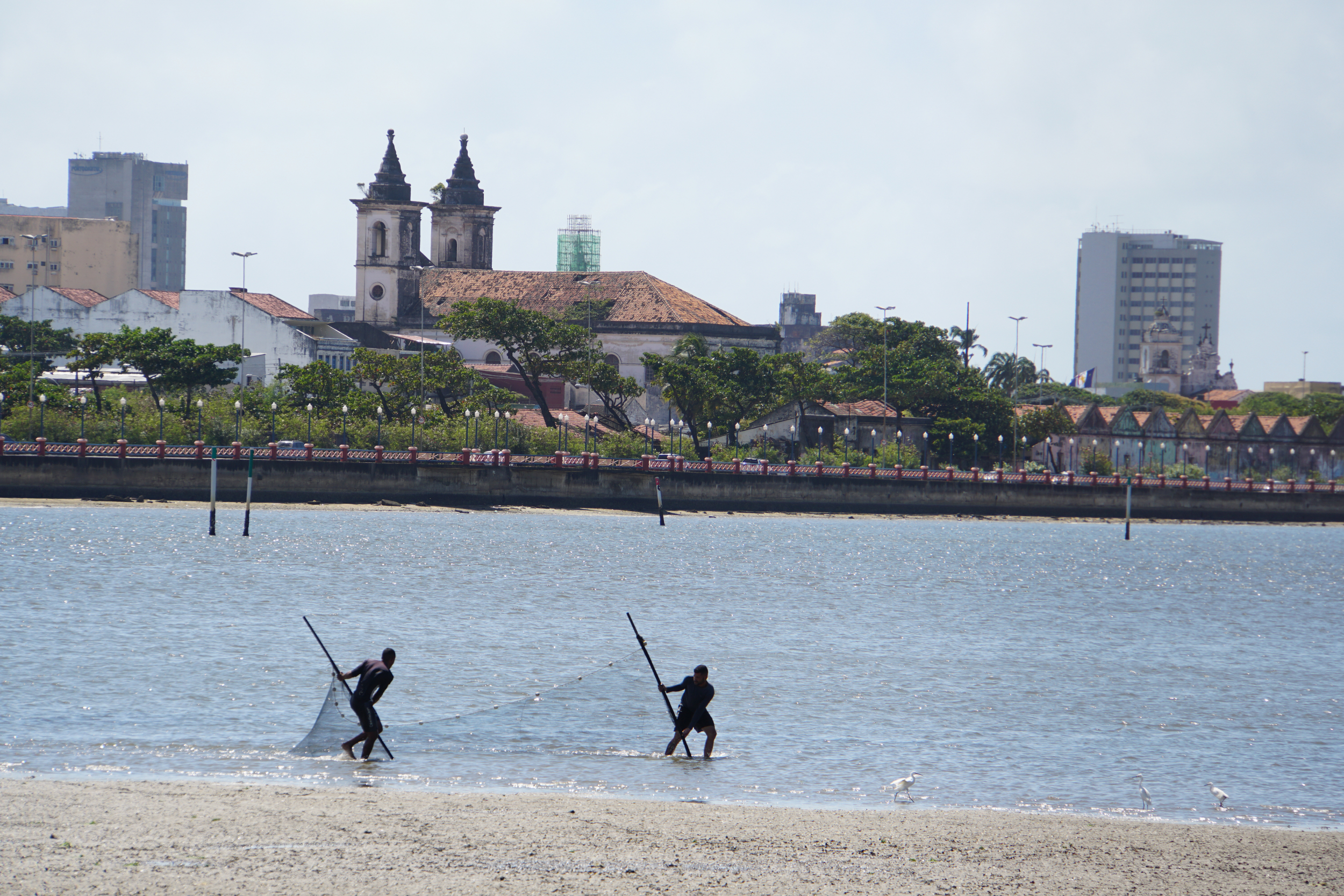 2. Fishing at low tide in Recife