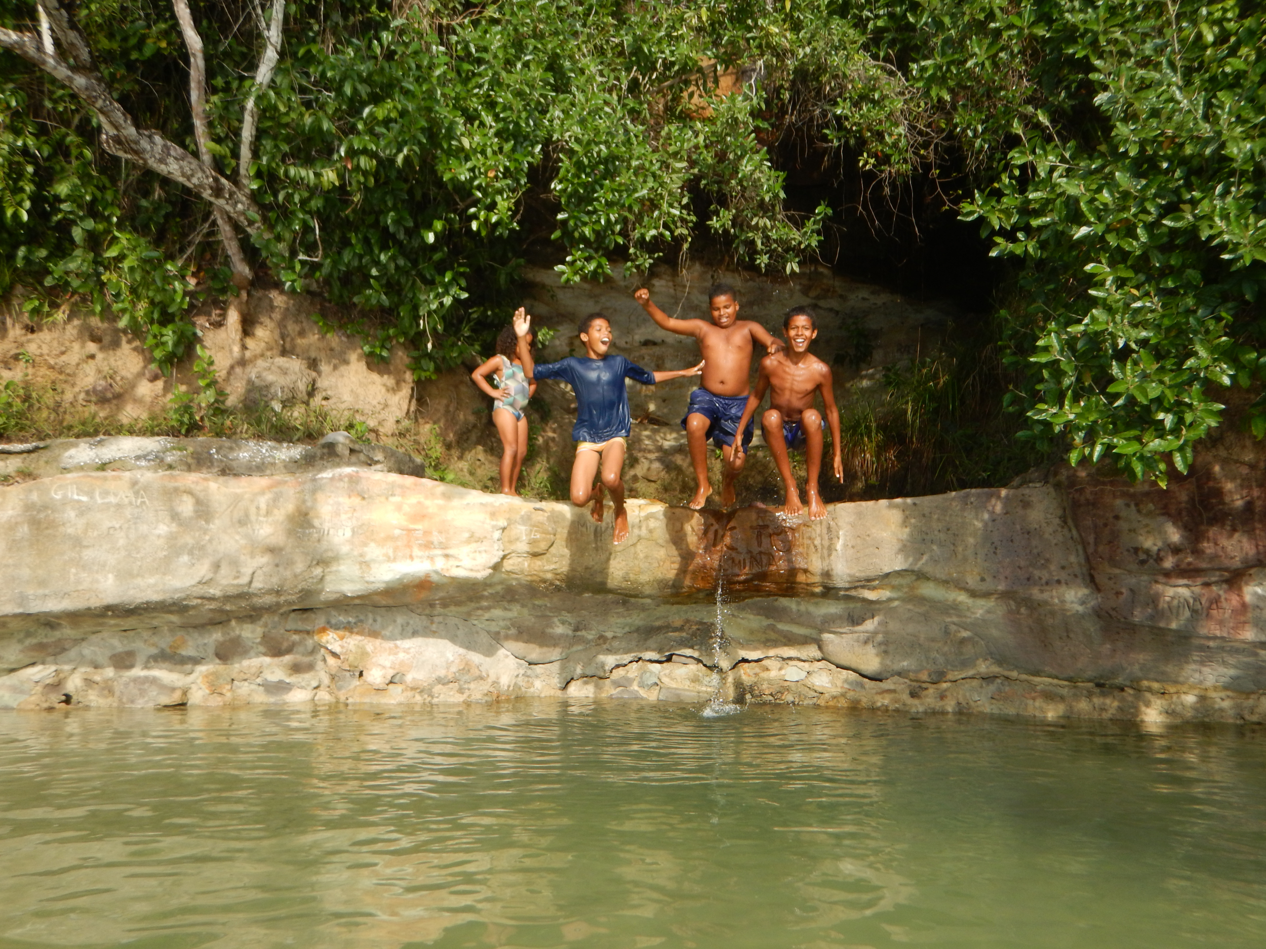 34. Local swimming hole, we were joined by a fisherman and his kids