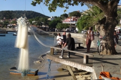 57. Repairing fishing net in Buzio