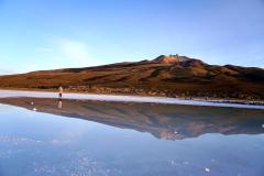33.-Dormant-Tunupa-volcano-reflects-in-the-salt-flat