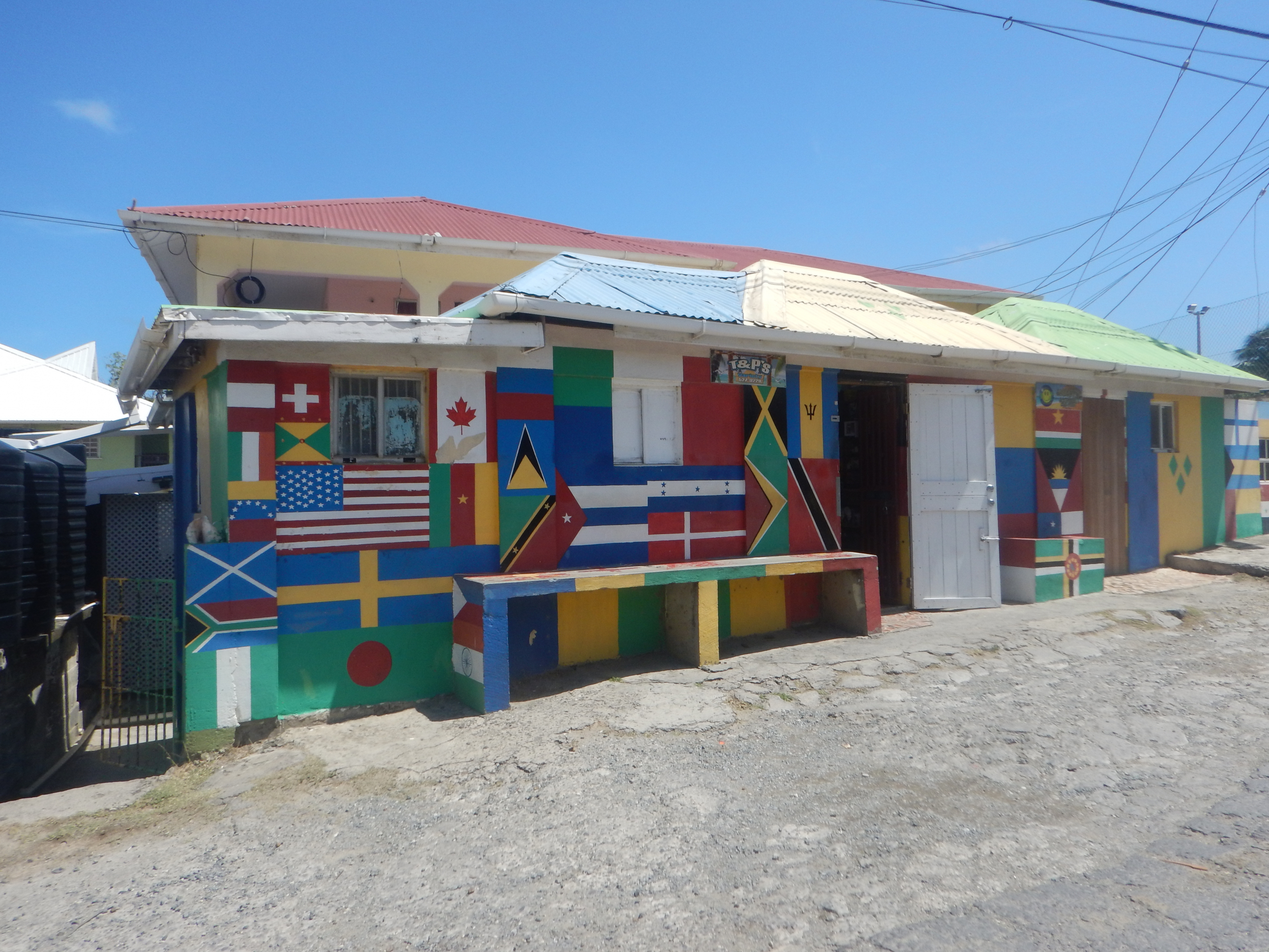 11. Shop in Canouan flying lots of colors